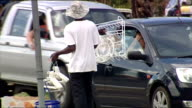 Exterior shots of poor street hawkers selling various items to passing drivers on December 05 2007 in Sandton South Africa