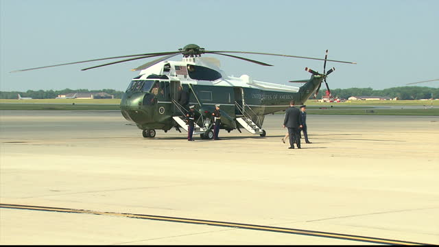 Exterior shots of President Barack Obama First Lady Michelle Obama departing Air Force One plane boarding Marine One at Joint Base Andrews on June 16...