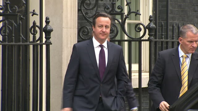 exterior shots of Prime Minister David Cameron exiting number 10 Downing street and get into car on the way to get sworn in at the House of Commons...
