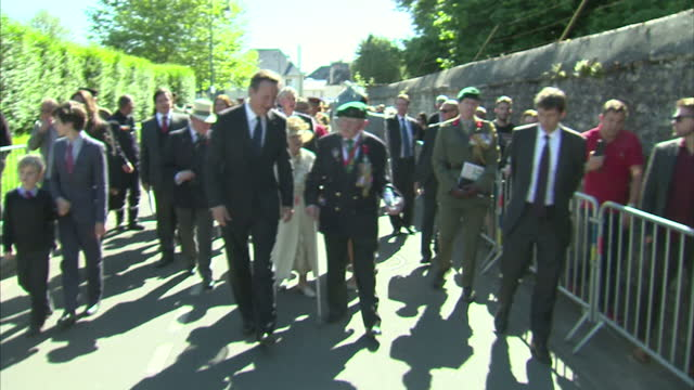 Exterior shots of Prime Minister David Cameron meeting veterans on DDay 70th Anniversary commemorations on June 06 2014 in Bayeux France