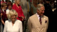 Exterior shots of Prince charles and Camilla Duchess of Cornwall watching and listening to choir men singing MUSIC PERFORMANCE MAY REQUIRE FURTHER...