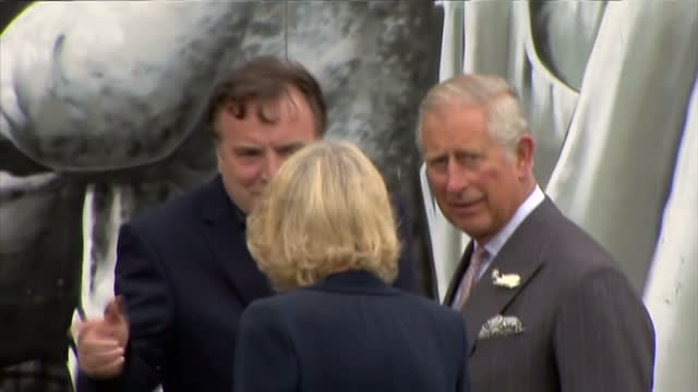 Exterior shots of Prince Charles and Camilla Duchess of Cornwall arriving to visit The Clutha bar and viewing a mural of famous singers and actors...