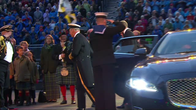 Exterior shots of Prince Charles and Prince William arriving to attend the Royal Edinburgh Military Tattoo at Edinburgh Castle being greeted by...