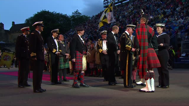 Exterior shots of Prince Charles and Prince William attending the Royal Edinburgh Military Tattoo at Edinburgh Castle and taking part in a ceremonial...
