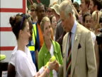 exterior shots of Prince Charles chatting to people backstage at the Glastonbury festival Exterior shots of Prince Charles chatting to various people...