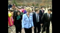 Exterior shots of Prince Charles Prince of Wales and Princess Diana Princess of Wales departing war memorial where young girls in traditional dress...