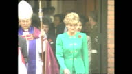 Exterior shots of Prince Charles Prince of Wales and Princess Diana Princess of Wales leaving church with priest after unveiling plaque during Royal...