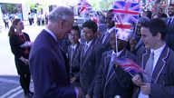 exterior shots of Prince Charles Prince of Wales arriving and greeting awaiting crowd of children waving Union flags at the opening of The Prince's...