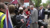 exterior shots of Prince Charles Prince of Wales arriving at East Belfast Network Centre and shake hands with members of the public on May 21 2015 in...