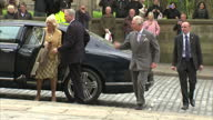 exterior shots of Prince Charles Prince of Wales Camilla Duchess of Cornwall arrive and greet crowds who hand them flowers and cards on their visit...