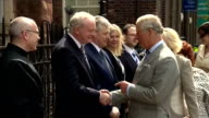exterior shots of Prince Charles Prince of Wales Camilla Duchess of Cornwall arrive at St Patrick's Church and shake hands with officials including...
