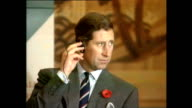 Exterior shots of Prince Charles Prince of Wales entering room and taking seat for Business Environment meeting during Royal tour on 6 November 1992...