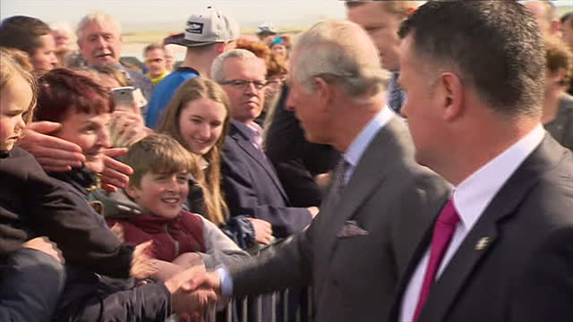 exterior shots of Prince Charles Prince of Wales shaking hands with members of the public at Mullaghmore on their visit to Mullaghmore on May 20 2015...