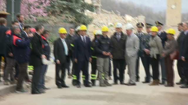 Exterior shots of Prince Charles visiting an area of Amatrice that was heavily damaged by an earthquake in August 2016 meeting local fire and rescue...