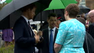 Exterior shots of Prince Harry attending a garden party at Hillsborough Castle and greeting officials and guests accompanied by Secretary of State...