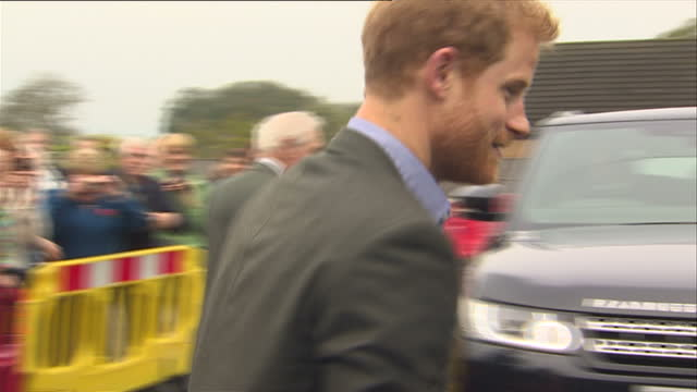 Exterior shots of Prince Harry bidding farewell to members of the public and departing after reopening a village hall on 23 October 2017 in St...