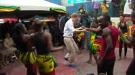 Exterior shots of Prince Harry dancing with children at Bustamente Hospital in Kingston Prince Harry wears blue suede shoes is on a four day visit to...