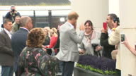 Exterior shots of Prince Harry greeting members of the public and a group of local schoolgirls before departing having visited tha Mac Theatre on...