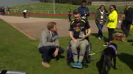 Exterior shots of Prince Harry meeting an injured exservice personnel and his Canine Partners assistance dog at trials before the Invictus Games on 7...