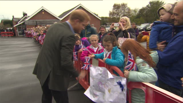 Exterior shots of Prince Harry meeting floodaffected residents and local school children on 23 October 2017 in St Michael's on Wyre United Kingdom