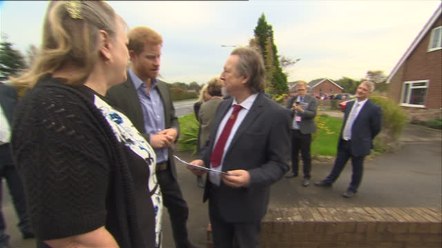 Exterior shots of Prince Harry meeting floodaffected residents on 23 October 2017 in St Michael's on Wyre United Kingdom