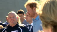 Exterior shots of Prince Harry observing man doing football tricks on his visit to the Streetsport Initiative Robert Gordon University on September...