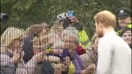 Exterior shots of Prince Harry speaking to staff and greeting members of the public looking on through a fence before departing on September 07 2017...