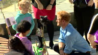 Exterior shots of Prince Harry talking to children participating in arts and crafts activities his visit to the Streetsport Initiative Robert Gordon...