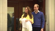Exterior shots of Prince William and Catherine Duchess of Cambridge Kate Middleton walk down steps of Lindo wing at St Marys Hospital waving to...