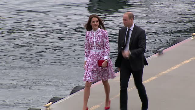 Exterior shots of Prince William and Catherine Duchess of Cambridge walking from a sea plane on arrival in Vancouver on September 25 2016 in...