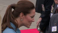 Exterior shots of Prince William Catherine Duke Duchess of Cambridge arrive for a wreathlaying ceremony and commemoration The duchess chats to...