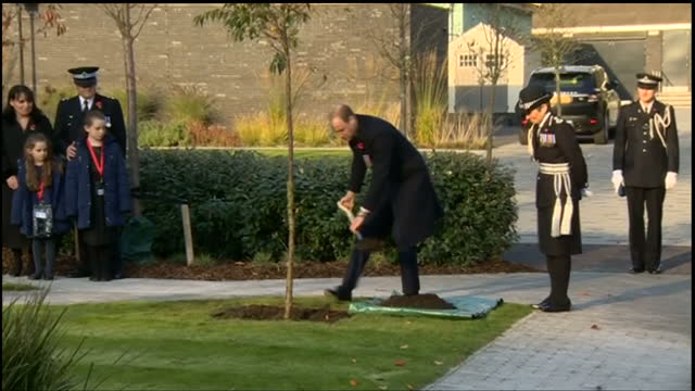 Exterior shots of Prince William planting a tree in the Memorial Garden of the Peel Centre and speaking with Metropolitan Police Commissioner...