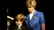Exterior shots of Princess Diana and Prince William watching a St David's day celebration parade from the balcony of St David's Hall Music and...