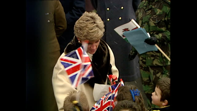Exterior shots of Princess Diana Princess of Wales greeting residents waving Union Jack flags on a visit to a British army base in Hohne on December...