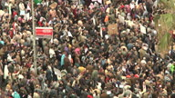 Exterior shots of protesters gathered in crowds part of an estimated million some holding banners and placards demanding President Mubarak to step...