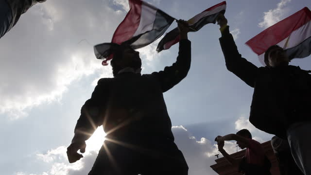 Exterior shots of Protesters in Egypt making another push to oust President Mubarak with the third week of mass demonstrations Protesters wave the...