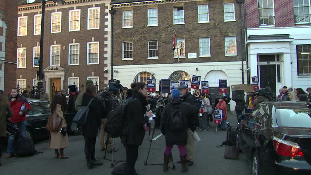 Exterior shots of protesters outside the Egyptian Embassy hold banners with 'Free AJ Staff' and their mouths taped up on December 29 2014 in London...