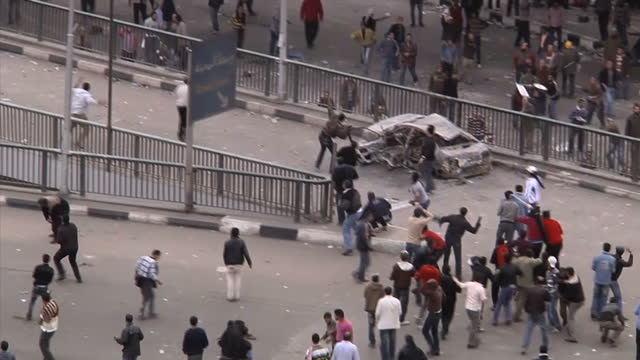 Exterior shots of protesters throwing lit fireworks into crowds of protesters on February 3 2011 in Cairo Egypt
