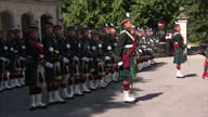 Exterior shots of Queen Elizabeth departing after inspecting the Argyll and Sutherland Highlanders at Balmoral Castle>> on August 07 2014 in Braemar...