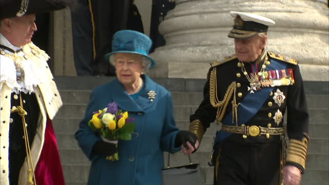 Exterior shots of Queen Elizabeth II and Prince Philip Duke of Edinburgh holding hands as they depart from St Paul's Cathedral after attending a...