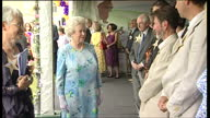 Exterior shots of Queen Elizabeth II and Prince Philip Duke of Edinburgh meeting guests at the Children's Garden Party on June 25 2006 at Buckingham...