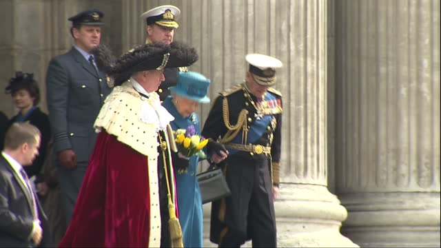 Exterior shots of Queen Elizabeth II and Prince Philip Duke of Edinburgh departing from St Paul's Cathedral after attending a memorial service to...