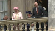 Exterior shots of Queen Elizabeth II and Prince Philip Duke of Edinburgh walk together onto balcony to wave to an awaiting crowd on June 22 2016 in...