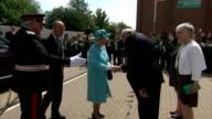 Exterior shots of Queen Elizabeth II arriving at Sydney Russell Comprehensive School on July 16 2015 in Dagenham England