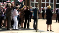 Exterior shots of Queen Elizabeth II being shown round Sydney Russell Comprehensive School on July 16 2015 in Dagenham England