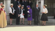 Exterior shots of Queen Elizabeth II departing a Service of Thanksgiving for the life and work of Lord Snowdon at Westminster Abbey chatting with...