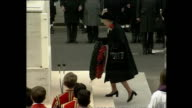 Exterior shots of Queen Elizabeth II laying a wreath at the Cenotaph on Remembrance Day followed by wreaths laid by Prince Philip Prince Charles...