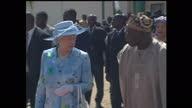 Exterior shots of Queen Elizabeth II Prince Philip Duke of Edinburgh escorted by Nigerian President Olusegun Obasanjo as they depart Abuja airport at...