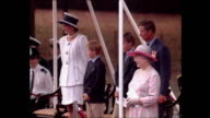 Exterior shots of Queen Elizabeth II Princess Diana Princess of Wales Prince Charles Prince of Wales watching VJ Day parade with Prince Harry and...