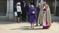 Exterior shots of Queen Elizabeth II with Dean of Westminster John Hall as she leaves with Prince Philip Duke of Edinburgh followed by Prince William...